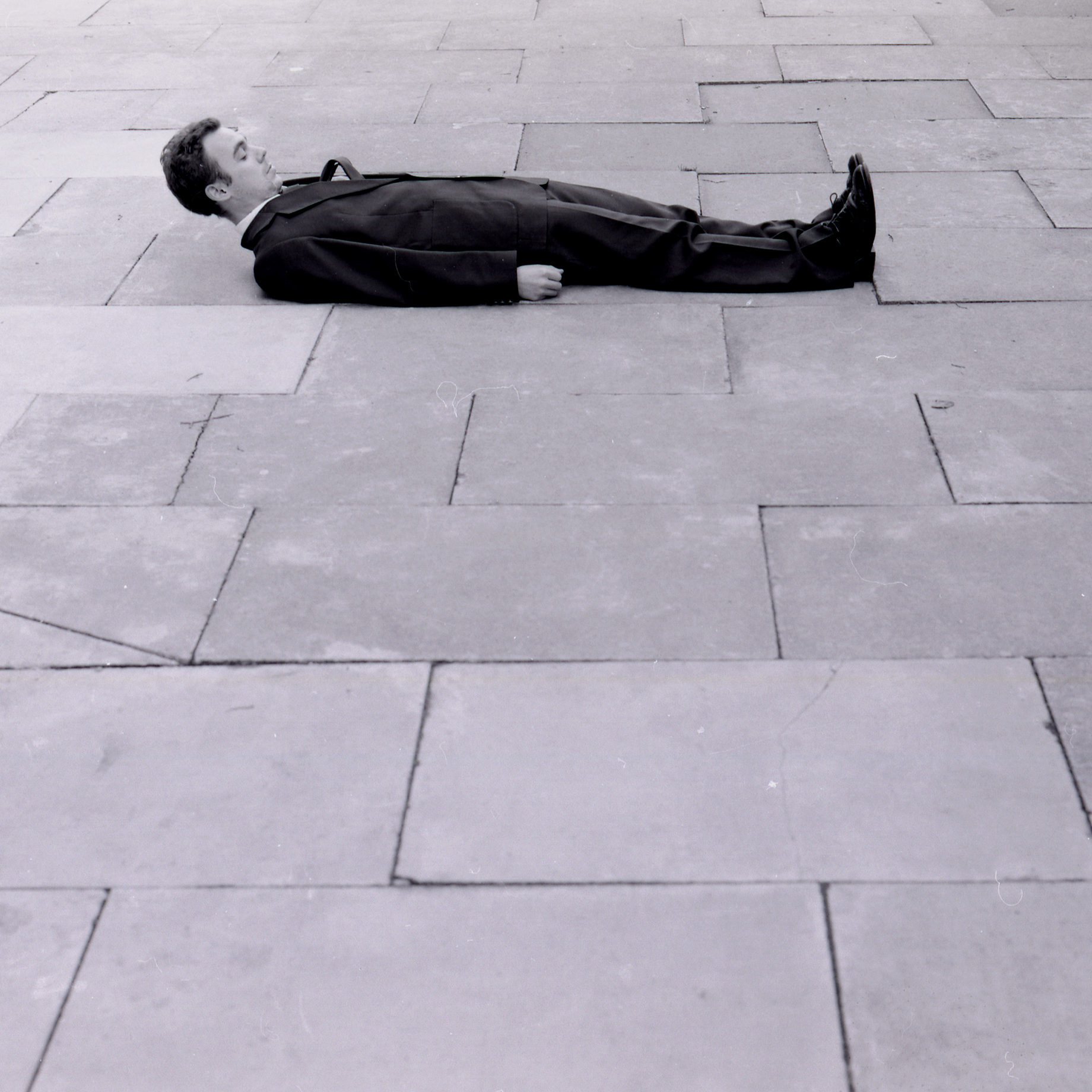 Alexander Costello, If I lie on the ground there is less chance of me falling over, Photograph of performance, 2001, Image credit Kathryn Wagland